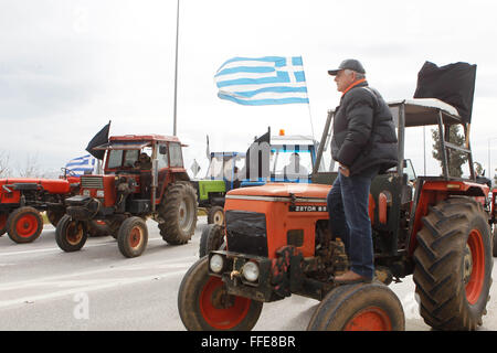 Athens, Greece. 12th Feb, 2016. Greek farmers cut the ways leading to Athens airport. Farmers from across Greece - Stock Photo
