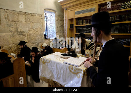 Ultra orthodox Jews praying at the synagogue of King David tomb in mount Zion Jerusalem Israel - Stock Photo