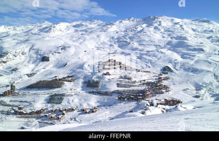 Aerial view of an alpine village, ski resort of Les Menuires, in 3 Valleys French Alps, with snowy slopes in high - Stock Photo