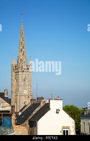Abseiling from church spire, Britany, France - Stock Photo