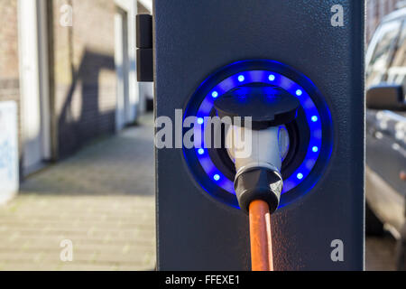 Plug in hybrid electric car charge point - Stock Photo