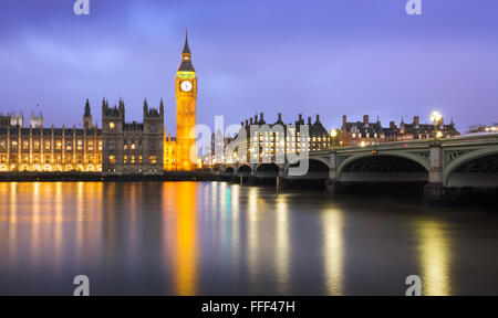 Westminster at dusk at a cloudy day, London, UK - Stock Photo