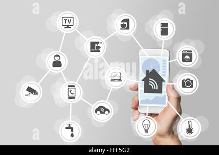 Smart home automation concept illustrated by modern smart phone to monitor smart objects. - Stock Photo