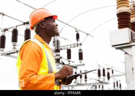male African electrical worker in substation - Stock Photo