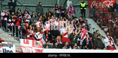 Gijon, Spain. 12th February, 2016. Rayo Vallecano's supporters encourage their team during football match of Spanish - Stock Photo