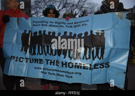 New York, United States. 12th Feb, 2016. Members of Picture the Homeless with banner. Several dozen activists representing - Stock Photo
