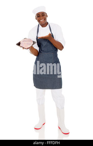 happy young African butcher presenting quality meat on white background - Stock Photo