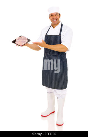 handsome mid age butcher presenting fresh raw meat - Stock Photo