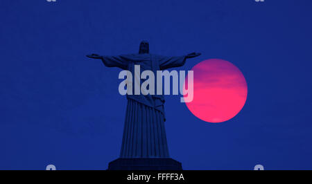 Sunset at The statue of Christ the Redeemer atop Corcovado, Rio de Janeiro, Brazil - Stock Photo