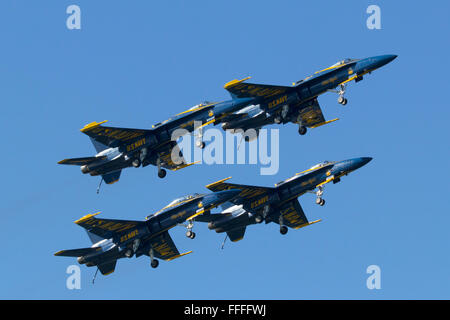 Blue Angels aircraft perform the Dirty Formation Pass as part of their flight demonstration over San Francisco Bay. - Stock Photo