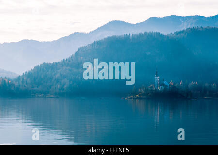Reflections on the lake of Bled in a cold autumn morning - Stock Photo