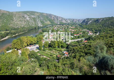 Neretva river and houses in Pocitelj village, Bosnia and Herzegovina. View from Pocitelj medieval castle - Stock Photo