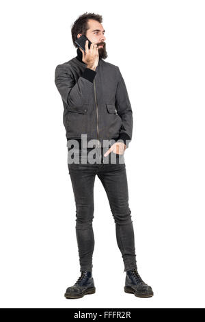 Cool hipster wearing jacket and military boots talking on the cellphone looking away. Full body length isolated - Stock Photo