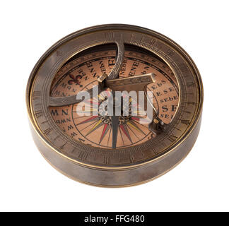 Ancient Brass Compass and Sundial. The image is a cut out, isolated on a white background, with a clipping path - Stock Photo