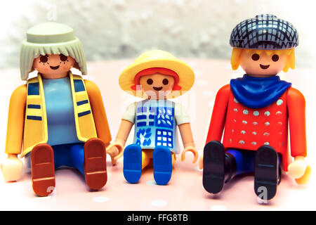 Three sitting figures from children's designer. A family. - Stock Photo
