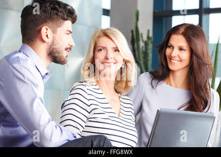 Image of business people sitting at job interview. Businesswomen and businessman discussing about future business - Stock Photo
