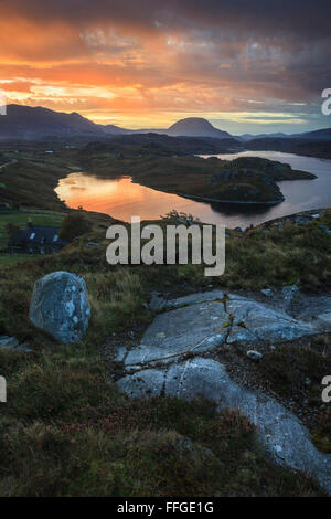 A vivid sunrise captured in late October, from above the north shore of Loch Inchard, near Kinlochbervie in North - Stock Photo