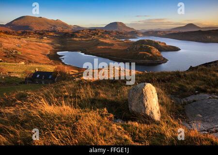 Loch Inchard near Kinlochbervie in Scotlan, with Foinaven, Arkle, Ben Stack in the distance. - Stock Photo