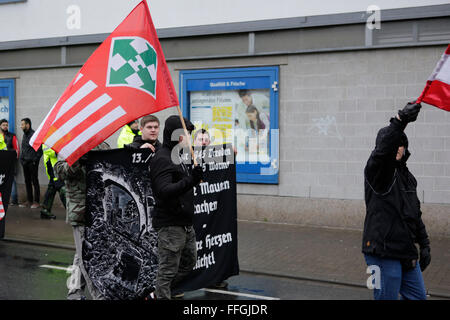 Worms, Germany. 13th Feb, 2016. Sympathizers from Hungary carry the flag of the former fascist Arrow Cross Hungarian - Stock Photo