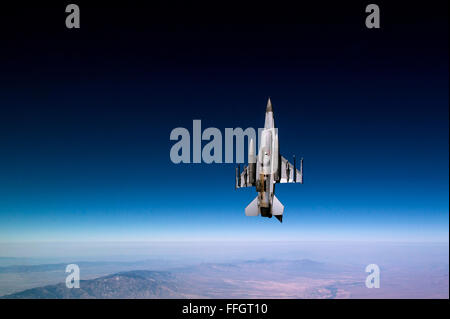 A Royal Netherlands Air Force F-16 Fighting Falcon flies a training mission over Tucson, AZ. - Stock Photo
