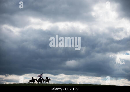 Retired Lt. Col. Brian Withrow rides toward the front lines alongside the commanding general and his staff during - Stock Photo