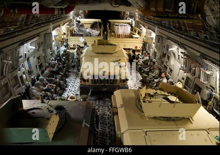 Bravo troop from the 5th Squadron, 73rd Regiment, 82nd Airborne Division, are transported to a drop zone by a C - Stock Photo