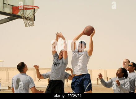 Members of the 380th Air Expeditionary Wing participate in sports day Feb. 25, 2012. The airmen and soldiers played - Stock Photo