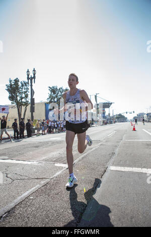 LA, California, USA. 13th Feb, 2016. Galen Rupp kicks away from the field to win the mens race in 2:11:13 at the - Stock Photo