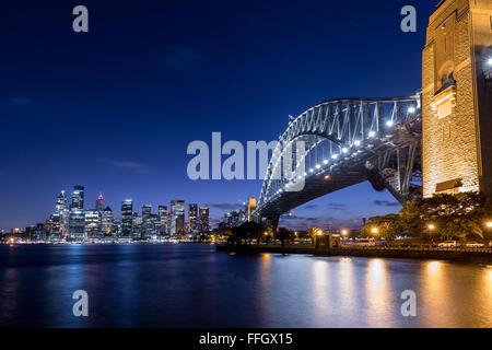 Sydney Harbour Bridge with the city at night. - Stock Photo
