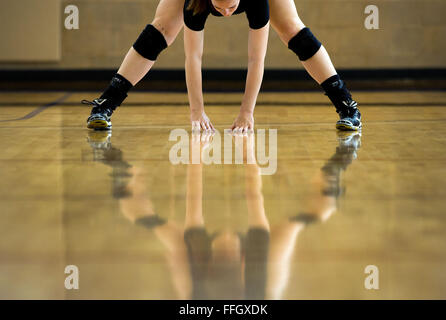 Airman 1st Class Meghan Haas stretches before volleyball practice at Hill Air Force Base, Utah. Haas and 10 other - Stock Photo