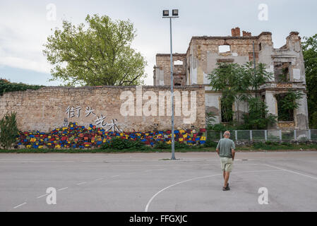 Abandoned building, detroyed during Bosnian War in Zrinjevac City Park, Mostar in Bosnia and Herzegovina - Stock Photo