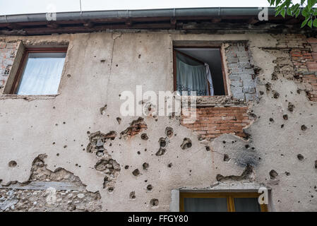Bullet holes from Bosnian War period on the building in Mostar city, Bosnia and Herzegovina - Stock Photo