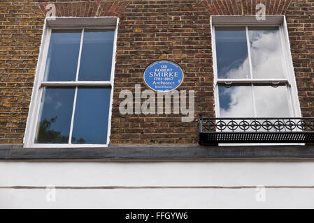 A commemorative blue plaque for Sir Robert Smirke (1 October 1780 – 18 April 1867) on display on a wall in London, - Stock Photo