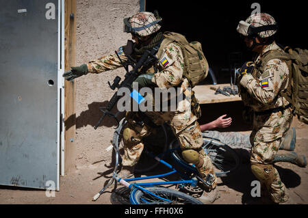 Columbian pararescuemen prepare to sweep a building during an exercise at the Playas Training and Research Center - Stock Photo