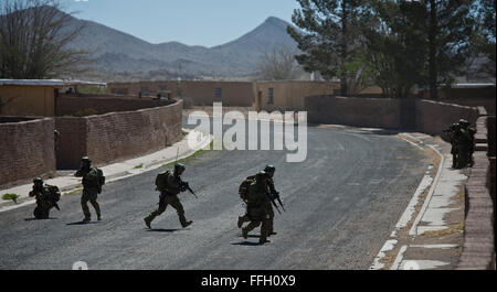 Chilean pararescuemen look for enemy forces as they move toward their destination in a personnel recovery exercise - Stock Photo