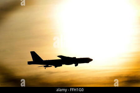 A B-52 Stratofortress aircraft flies back to Minot Air Force Base, N.D., after completing a routine sortie. - Stock Photo