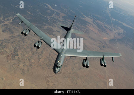 A B-52 Stratofortress assigned to the 2nd Bomb Wing flies over Utah. - Stock Photo
