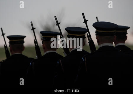 Members of the Army's 3rd Infantry Regiment's Caisson Platoon march away after honoring Army Air Forces Sgt. Charles - Stock Photo