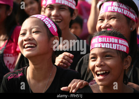 Philippines. 14th Feb, 2016. A group of participants laugh as they watch the One Billion Rising performers in Rizal - Stock Photo