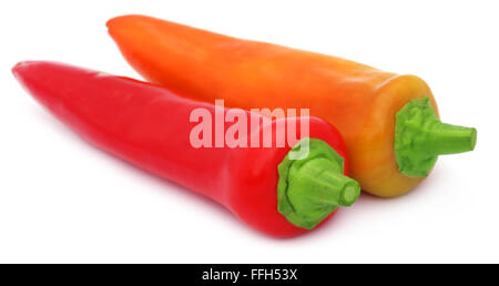 Two fresh banana peppers over white background - Stock Photo