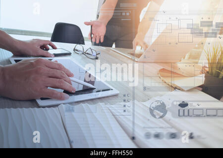 two colleagues interior designer discussing data and digital tablet and computer laptop with sample material and - Stock Photo
