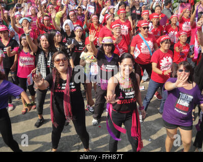 Manila, Philippines. 14th Feb, 2016. Stage actress Monique Wilson, center right, participates in a global campaign - Stock Photo