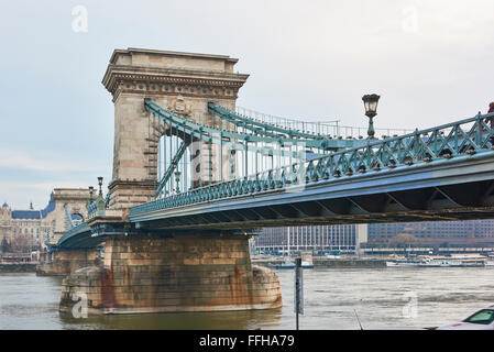 Low angle shot of Széchenyi Chain Bridge accross Danube River. February 02, 2016 in Budapest, Hungary. - Stock Photo