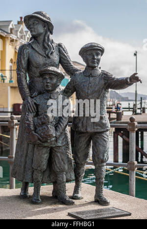 Statue of Annie Moore, the first immigrant to the US to pass through the Ellis Island facility, at Cobh Harbor, Ireland.