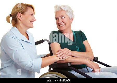 Eldercare for disabled senior woman in wheelchair - Stock Photo