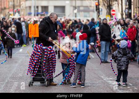 Manchester celebrates Chinese New Year today (Sunday 7th Feb 2016) . A man sells decorations to children - Stock Photo