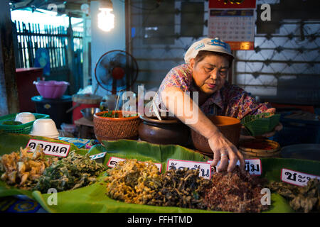 Woman seller. Food stall. Fish, vegetables, fast food. Ko Kret (also Koh Kred) is an island in the Chao Phraya River, - Stock Photo