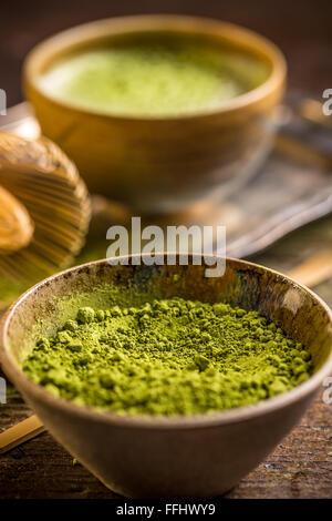 Matcha tea powder in a bowl - Stock Photo