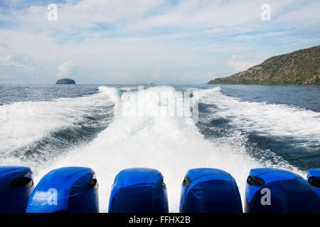 Water trail behind moving motor boat. Stock image - Stock Photo