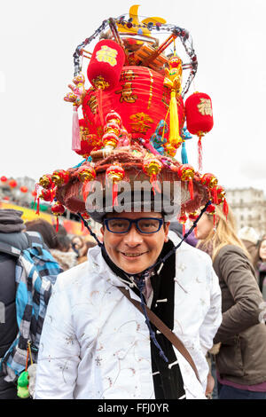 London, UK. 14th Feb 2016. A participant wears a colourful Chinese lantern hat as part of the festivities as thousands - Stock Photo